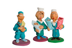 Statuette of doctors with three babies in their stock images