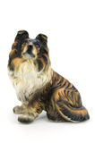 Statuette of dog. Isolated on white background Royalty Free Stock Photos