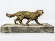 Statuette of a dog made of bronze stock photography