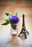 Statuette of Eiffel Tower and wedding rings Royalty Free Stock Photo