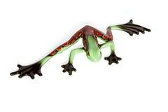 Statuette eines grünen Frosches mit roten Stellen Lizenzfreie Stockbilder