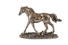 Statuette en bronze d'un cheval courant images stock