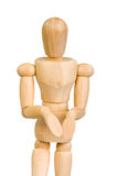Statuette figure wooden man human makes shows experiences emotional action on a white background. Stock Photography