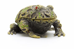 Statuette of a frog. Close up on a white background royalty free stock image