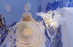 Statuette of a girl in a lace dress on a blue background royalty free stock photos