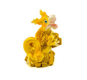Statuette of gold dragon with money isolated on a white background Royalty Free Stock Photos
