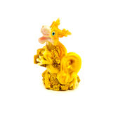 Statuette of gold dragon with money isolated on a white background. Photo of statuette of gold dragon with money isolated on a white background stock photography