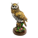 Statuette of gold owl with flowers isolated on a white background. Photo of statuette of gold owl with flowers isolated on a white background stock photo