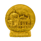 Statuette of gold plate with building isolated on a white background. Photo of statuette of gold plate with building on a stand isolated on a white background royalty free stock photography