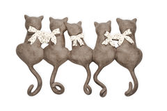 Statuette of a group cats. Statuette of clay cats group turned backwards isolated on white background Royalty Free Stock Photography