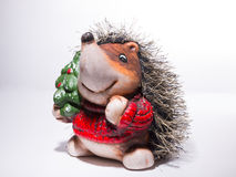 Statuette of a Hedgehog in Christmas red sweater with a Christma Stock Image