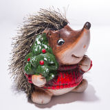 Statuette of a Hedgehog in Christmas red sweater with a Christma Royalty Free Stock Images