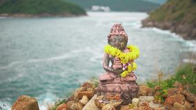 Statuette of the Holy deity, mounted on top of a high cliff above the Bay. Place of religious worship.  stock footage