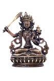 Statuette of Manjushri brandishing sword of wisdom. Royalty Free Stock Images