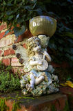 Statuette of musician elf garden. Stock Photos