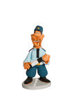 Statuette of policeman with a stick on the road Royalty Free Stock Photography