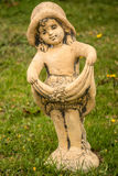 Statuette. Pretty Girl Statue in the garden royalty free stock photos