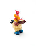 Statuette rooster candleholder with a candle. Statuette rooster candleholder with a candle, on white stock images