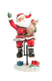 Statuette of Santa Claus. On a bike with a dog, Happy New Year Stock Images