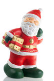 Statuette of Santa Claus with a gift Stock Photography