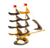 Statuette of ship made from shell isolated on a white background. Photo of statuette of ship made from shell isolated on a white background stock images