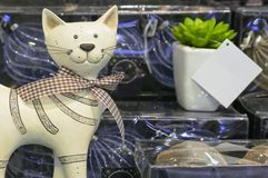 Statuette of a smiling cat with a bow in a souvenir shop royalty free stock photo