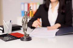 Statuette of Themis - the goddess of justice on lawyer's desk Royalty Free Stock Photos