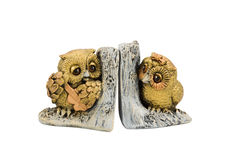 Statuette two owls on branch Royalty Free Stock Photography