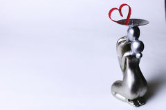 Statuette valentine with hearts Royalty Free Stock Images