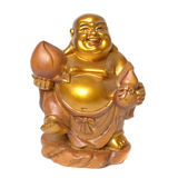 Statuette von einem lächelnden goldenen Buddha Stockbild