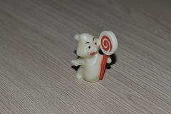 Statuette of a white Ghost with a Lollipop. royalty free stock image