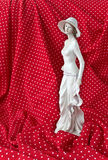 Statuette of a woman in a white dress Royalty Free Stock Photo