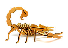 Statuette of wooden scorpion isolated on a white background. Statuette of brown wooden scorpion isolated on a white background royalty free stock images