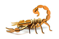 Statuette of wooden scorpion isolated on a white background. Statuette of brown wooden scorpion isolated on a white background royalty free stock image