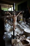 Statuettes of Jesus on crucifix in thrift store Royalty Free Stock Image