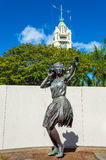 Stature Fronting Aloha Tower Stock Images