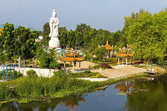 Stature white marble Quan Yin. Stand near The Bridge of the River Kwai Kanchanaburi, Thailand Royalty Free Stock Images