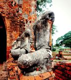 Status. Buddha statues damaged in historical park Ayutthaya .Thailand.This is a public place can publish and unlimited use Stock Photo