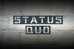 Status quo GR. Status quo stencil print on the grunge white brick wall Royalty Free Stock Image