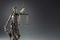 Statute of Justice. Bronze statue Lady Justice holding scales an Royalty Free Stock Photo