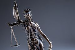 Statute of Justice. Bronze statue Lady Justice holding scales an Stock Images