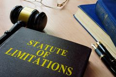 Statute of limitations SOL on a court desk. Statute of limitations SOL and gavel on a court desk Stock Photos