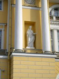 Statute in the wall of the house Stock Image