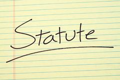 Statute On A Yellow Legal Pad. The word `Statute` underlined on a yellow legal pad Royalty Free Stock Photography