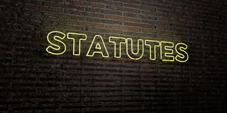 STATUTES -Realistic Neon Sign on Brick Wall background - 3D rendered royalty free stock image Royalty Free Stock Photos
