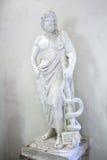 Staty av Asclepius i museum av Epidauros Arkivfoton