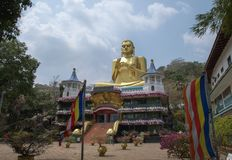 Staty av Buddha i Dambulla Arkivfoto