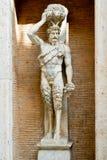 Staty av den romerska guden av faunen i Rome royaltyfria bilder