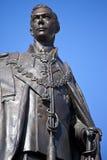 Staty av droppen för konung George i London Arkivfoto