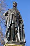 Staty av droppen för konung George i London Royaltyfri Foto